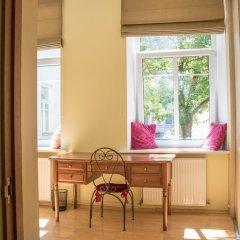 Отель Deluxe Old Town Apartment Литва, Вильнюс - отзывы, цены и фото номеров - забронировать отель Deluxe Old Town Apartment онлайн комната для гостей фото 4