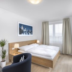 Апартаменты CityWest Apartments комната для гостей фото 3