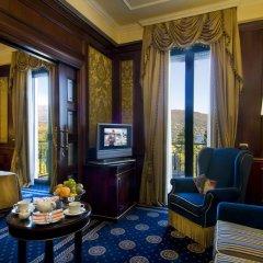 Отель SIMPLON Бавено сейф в номере