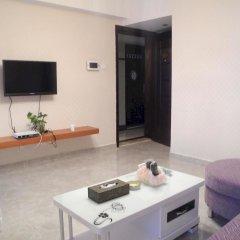 Апартаменты Shenzhen Xin Phoenix Gang Ao 8 Apartment удобства в номере