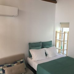 Апартаменты Centenary Fontainhas Apartments Порту комната для гостей