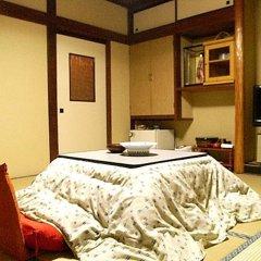 Отель Hayato Ryokan Цуруока сейф в номере