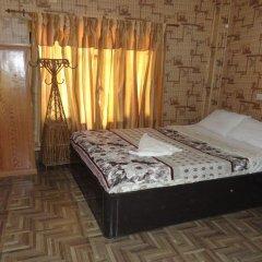 Отель Chitwan Adventure Resort Непал, Саураха - отзывы, цены и фото номеров - забронировать отель Chitwan Adventure Resort онлайн комната для гостей фото 5