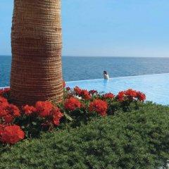 Отель Vidamar Resort Madeira - Half Board Only Португалия, Фуншал - отзывы, цены и фото номеров - забронировать отель Vidamar Resort Madeira - Half Board Only онлайн пляж фото 2