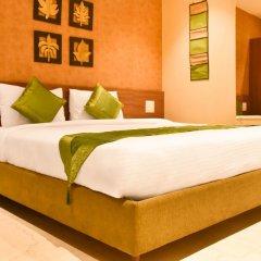 Отель Treebo Ryaan сейф в номере