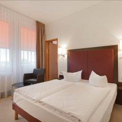 Отель AZIMUT Hotel Munich Германия, Мюнхен - 10 отзывов об отеле, цены и фото номеров - забронировать отель AZIMUT Hotel Munich онлайн комната для гостей фото 4