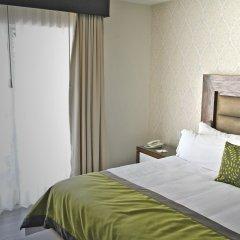 Áurea Hotel & Suites комната для гостей