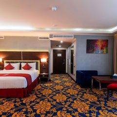 Ramada Hotel & Suites by Wyndham Yerevan in Yerevan, Armenia from 89$, photos, reviews - zenhotels.com guestroom