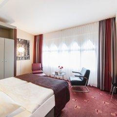 Отель AZIMUT Hotel Cologne Германия, Кёльн - 13 отзывов об отеле, цены и фото номеров - забронировать отель AZIMUT Hotel Cologne онлайн комната для гостей фото 2