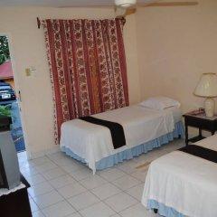 Отель Palm Bay Guest House & Restaurant Ямайка, Монтего-Бей - отзывы, цены и фото номеров - забронировать отель Palm Bay Guest House & Restaurant онлайн комната для гостей фото 4