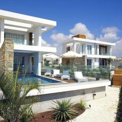 Отель Paradise Cove Luxurious Beach Villas Кипр, Пафос - отзывы, цены и фото номеров - забронировать отель Paradise Cove Luxurious Beach Villas онлайн вид на фасад фото 4