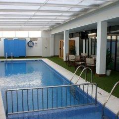 Отель Apartamentos Loar Ferreries бассейн фото 2