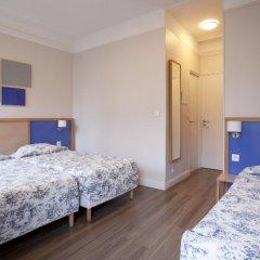 Отель Est Hôtel Париж сейф в номере