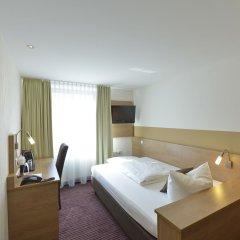 Отель Cristal München Германия, Мюнхен - 9 отзывов об отеле, цены и фото номеров - забронировать отель Cristal München онлайн комната для гостей фото 2