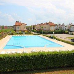 Отель Paradise Town - Villa Colm бассейн