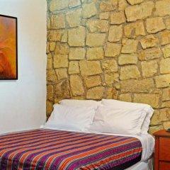 Отель La Casa Rosada Копан-Руинас комната для гостей