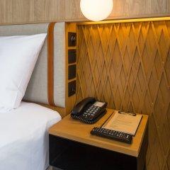 Отель Craftsman Bangkok сейф в номере