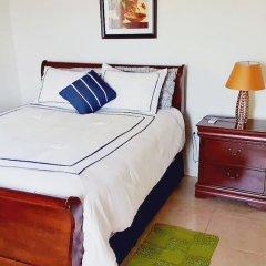 Отель I Heart JA Affordable Luxury Runaway Bay Ямайка, Ранавей-Бей - отзывы, цены и фото номеров - забронировать отель I Heart JA Affordable Luxury Runaway Bay онлайн комната для гостей фото 2