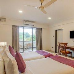 Отель Treebo Tryst Dona Paula Гоа комната для гостей фото 4