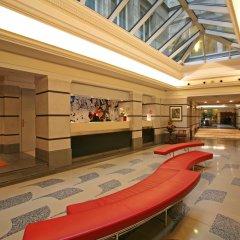 Отель Aria Hotel by Library Hotel Collection Чехия, Прага - 5 отзывов об отеле, цены и фото номеров - забронировать отель Aria Hotel by Library Hotel Collection онлайн интерьер отеля