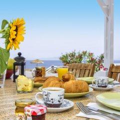 Отель Oia Sunset Villas Греция, Остров Санторини - отзывы, цены и фото номеров - забронировать отель Oia Sunset Villas онлайн питание фото 3