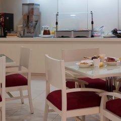 Отель City Express Buenavista гостиничный бар