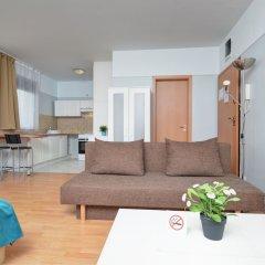 Апартаменты Agape Apartments комната для гостей фото 6