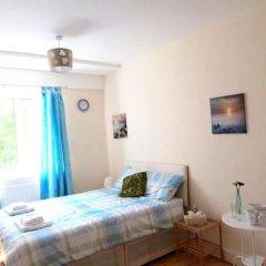 Апартаменты 4 Bedroom Apartment in Kilburn With Private Balcony комната для гостей фото 3