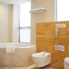 Howard Johnson All Suites Hotel ванная фото 2