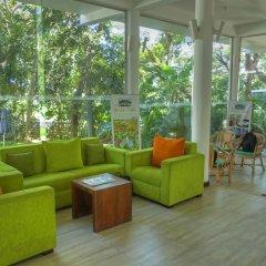 The Rain Tree Hotel интерьер отеля