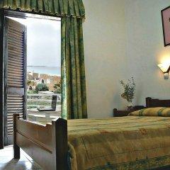 Апартаменты Iliostasi Beach Apartments комната для гостей фото 2