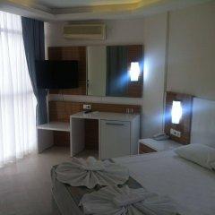 Отель Poseidon Cesme Resort � All Inclusive Чешме комната для гостей