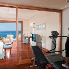 Отель Grand Resort Lagonissi фитнесс-зал фото 2