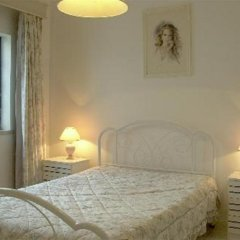 Отель Apartamentos Sereia da Oura комната для гостей