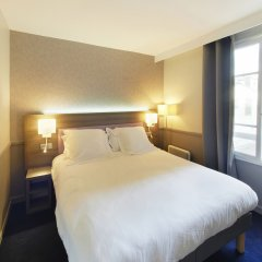 Отель POUSSIN Париж комната для гостей фото 5