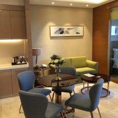 Отель Golden Tulip Suzhou Residence интерьер отеля