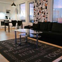 Апартаменты Local Nordic Apartments - Arctic Fox Ювяскюля комната для гостей фото 2