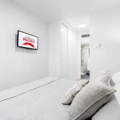 Апартаменты Villanueva Apartments by FlatSweetHome комната для гостей