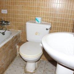 Отель Xcape Hotels and Suites Ltd Нигерия, Калабар - отзывы, цены и фото номеров - забронировать отель Xcape Hotels and Suites Ltd онлайн ванная фото 2