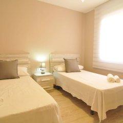 Отель HomeHolidaysRentals Apartamento Canet Playa l - Costa Barcelona комната для гостей