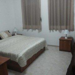 Отель Pirin Private Houses Сандански комната для гостей фото 2