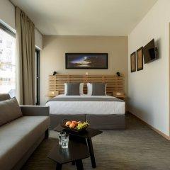 Отель Fos DownTown Suites Афины комната для гостей фото 7