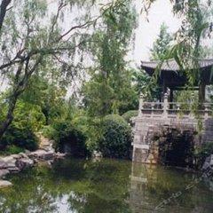 Отель Tangzonglong Hotel (Xi'an Qujiang Big Wild Goose Pagoda North Square Music Fountain) Китай, Сиань - отзывы, цены и фото номеров - забронировать отель Tangzonglong Hotel (Xi'an Qujiang Big Wild Goose Pagoda North Square Music Fountain) онлайн приотельная территория фото 2