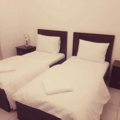 Отель Al Bishr Hotel Apartments ОАЭ, Шарджа - отзывы, цены и фото номеров - забронировать отель Al Bishr Hotel Apartments онлайн комната для гостей фото 2