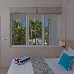 Отель Malahini Kuda Bandos Resort комната для гостей фото 5