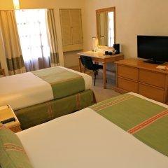 Отель Binniguenda Huatulco - Все включено удобства в номере
