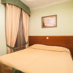Мини-Отель Комфитель Александрия комната для гостей фото 2