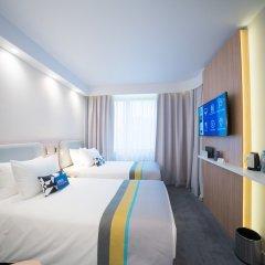 Отель Holiday Inn Express Moscow Baumanskaya Москва комната для гостей фото 3