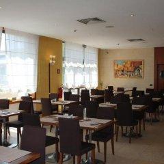 Отель MH Hotel Piacenza Fiera Италия, Пьяченца - отзывы, цены и фото номеров - забронировать отель MH Hotel Piacenza Fiera онлайн питание фото 3