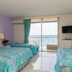 Отель Blue Lagoon Beach Studio At Montego Club Resort Ямайка, Монтего-Бей - отзывы, цены и фото номеров - забронировать отель Blue Lagoon Beach Studio At Montego Club Resort онлайн комната для гостей фото 4
